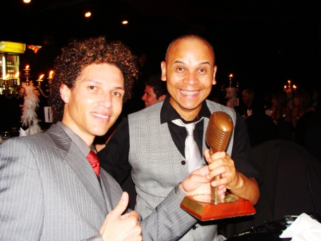 Sean Burke and Marvin Moses with the Award
